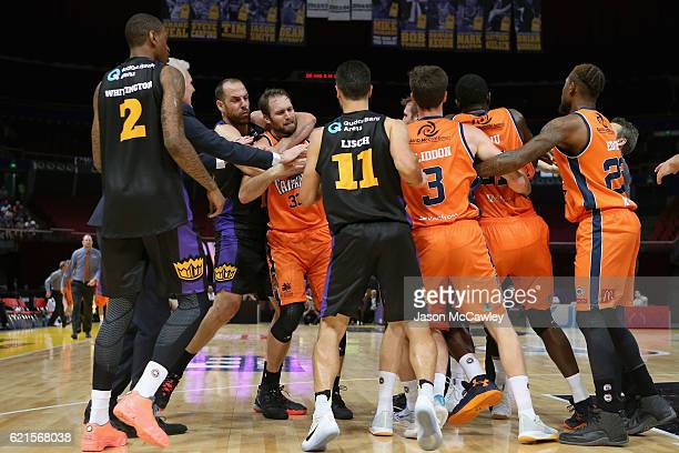 Aleks Maric of the Kings holds Mark Worthington of the Taipans during the round five NBL match between the Sydney Kings and the Cairns Taipans at...