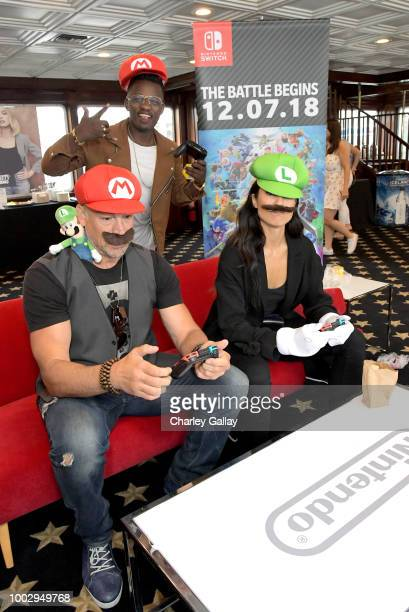 Aleks Paunovic Trezzo Mahoro and Jennifer Cheon put their gaming skills to the test playing Mario Kart 8 Deluxe on Nintendo Switch at the Variety...