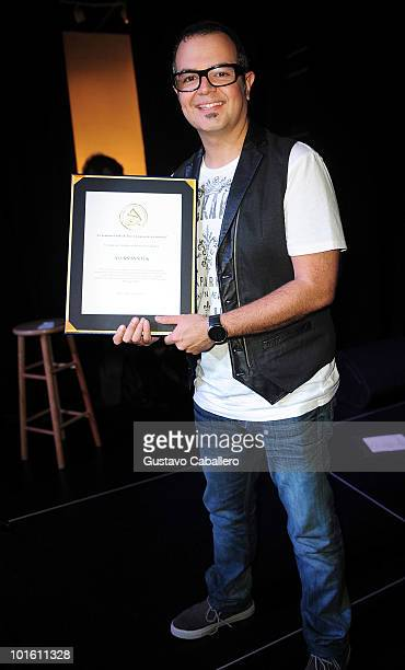 Aleks Syntek receives an award at the Latin Recording Academy Acoustic Sessions at The Awarehouse on June 3 2010 in Miami Florida