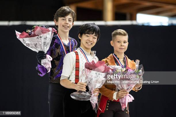 Aleksa Rakic of Canada Yuma Kagiyama of Japan and Andrei Kutovoi of Russia pose during a medal ceremony after Junior Men Free Skating at the ISU...