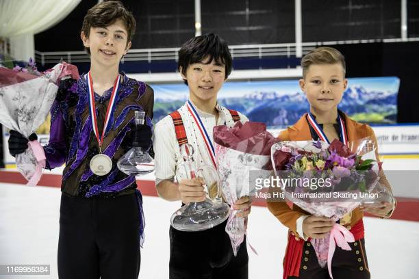 Aleksa Rakic of Canada Yuma Kagiyama of Japan and Andrei Kutovoi of Russia pose after a medal ceremony after Junior Men Free Skating at the ISU...