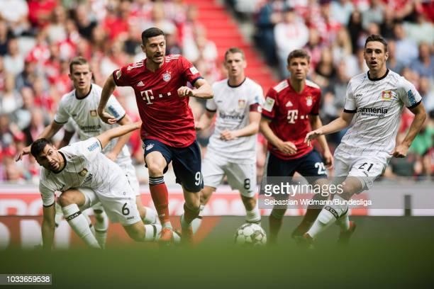 Aleksandar Dragovic and Dominik Kohr of Bayer 04 Leverkusen compete with Robert Lewandowski of Bayern Muenchen for the ball during the Bundesliga...