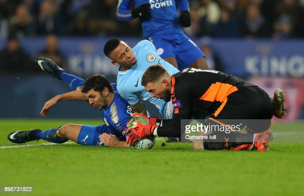 Aleksandar Dragovic and Leicester City goalkeeper Ben Hamer collide with Gabriel Jesus of Manchester City during the Carabao Cup QuarterFinal match...
