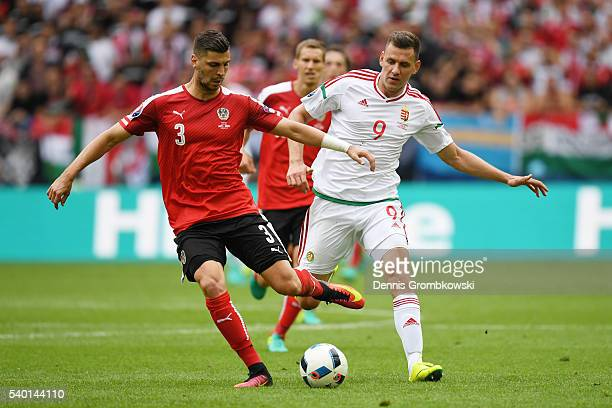 Aleksandar Dragovic of Austria and Adam Szalai of Hungary compete for the ball during the UEFA EURO 2016 Group F match between Austria and Hungary at...