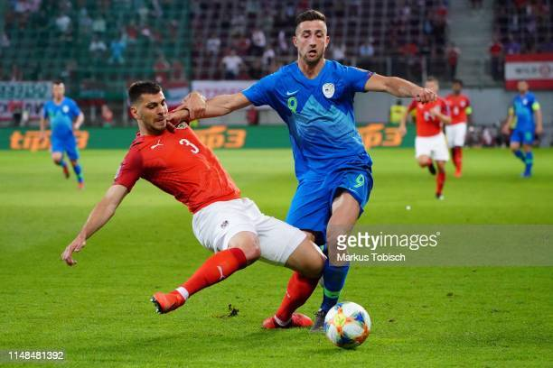 Aleksandar Dragovic of Austria and Andraz Sporar of Slovenia during the UEFA Euro 2020 Qualifier match between Austria and Slovenia at Woerthersee...