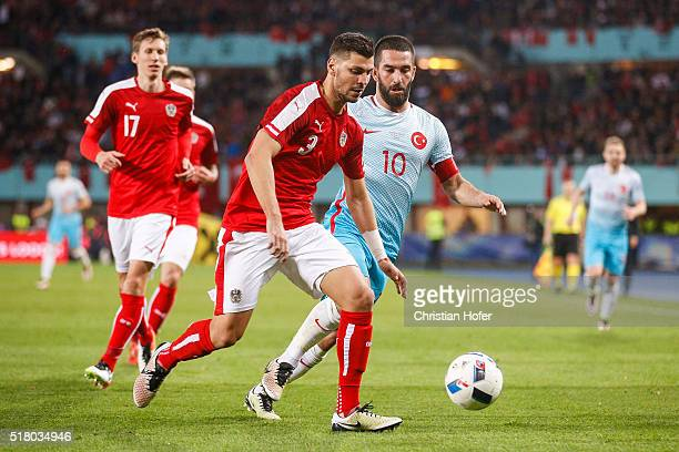 Aleksandar Dragovic of Austria competes for the ball with Arda Turan of Turkey during the international friendly match between Austria and Turkey at...