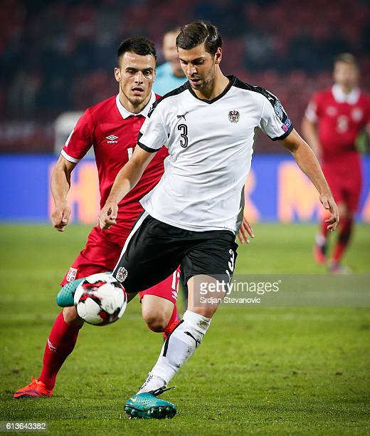 Aleksandar Dragovic of Austria in action against Filip Kostic of Serbia during the FIFA 2018 World Cup Qualifier between Serbia and Austria at...