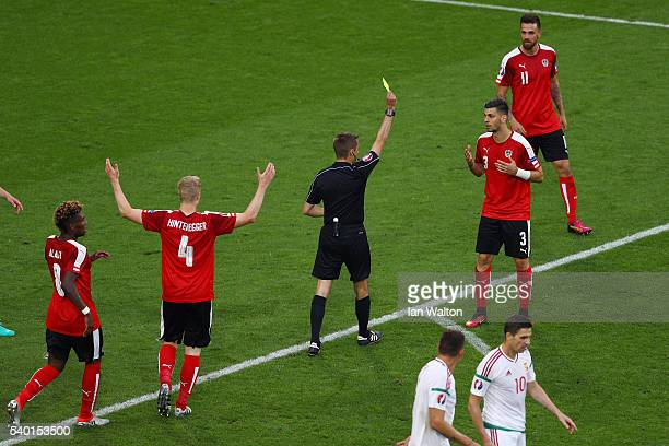 Aleksandar Dragovic of Austria is shown the second yellow card by referee Clement Turpin during the UEFA EURO 2016 Group F match between Austria and...