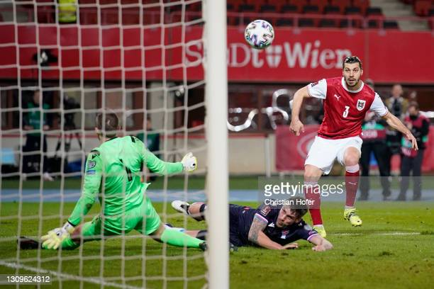 Aleksandar Dragovic of Austria scores their side's first goal during the FIFA World Cup 2022 Qatar qualifying match between Austria and the Faroe...