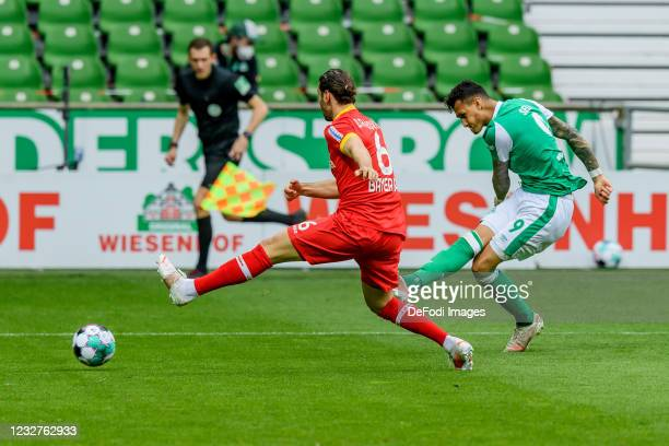 Aleksandar Dragovic of Bayer 04 Leverkusen and Davie Selke of SV Werder Bremen battle for the ball during the Bundesliga match between SV Werder...