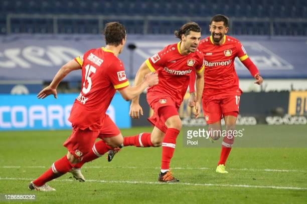 Aleksandar Dragovic of Bayer 04 Leverkusen celebrates with teammates Julian Baumgartlinger and Kerem Demirbay after scoring his team's second goal...