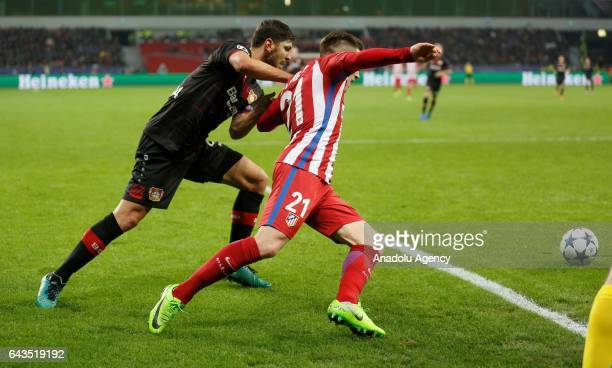 Aleksandar Dragovic of Bayer Leverkusen in action against Kevin Gameiro of Atletico Madrid during the UEFA Champions League round of sixteen soccer...