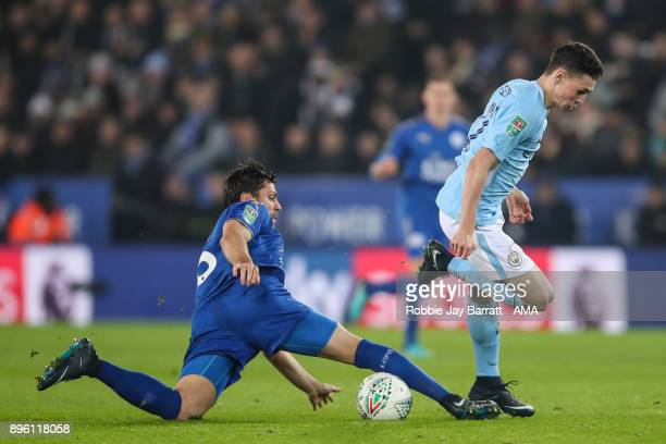 Aleksandar Dragovic of Leicester City and Phil Foden of Manchester City during the Carabao Cup QuarterFinal match between here Leicester City v...