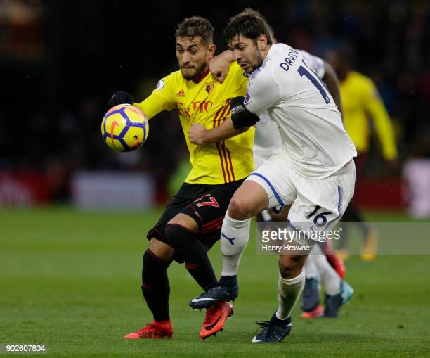 Aleksandar Dragovic of Leicester City and Roberto Pereyra of Watford during the Premier League match between Watford and Leicester City at Vicarage...