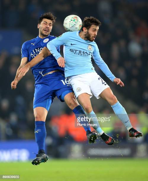 Aleksandar Dragovic of Leicester City in action with Bernado Silva of Manchester City during the Carabao Cup QuarterFinal match between Leicester...