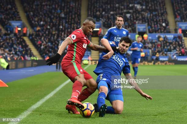 Aleksandar Dragovic of Leicester City makes a tackle on Jordan Ayew of Swansea City during the Premier League match between Leicester City and...
