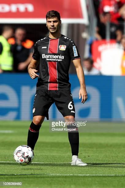 Aleksandar Dragovic of Leverkusen runs with the ball during the Bundesliga match between Bayer 04 Leverkusen and VfL Wolfsburg at BayArena on...