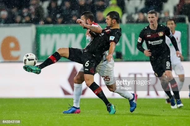 Aleksandar Dragovic of Leverkusen und Raul Bobadilla of Augsburg battle for the ball during the Bundesliga match between FC Augsburg and Bayer 04...