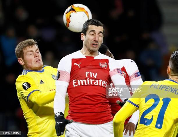 Aleksandar Filipovic of BATE Borisov Henrikh Mkhitaryan and Ainsley MaitlandNiles of Arsenal vie for a header during the UEFA Europa League Round of...
