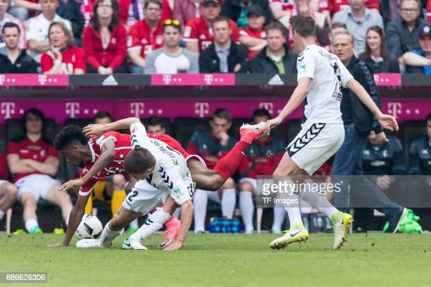 Aleksandar Ibnjovski of Freiburg Kingsley Coman of Bayern Muenchen battle for the ball during the Bundesliga match between Bayern Muenchen and SC...