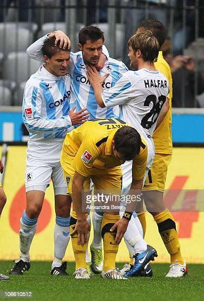 Aleksandar Ignjovski Alexander Ludwig and Daniel Halfar of Muenchen celebrate their first goal during the Second Bundesliga match between 1860...