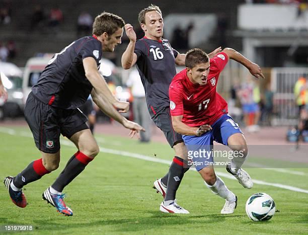Aleksandar Ignjovski of Serbia in action against David Vaughan of Wales during the FIFA 2014 World Cup Qualifier at stadium Karadjordje Park between...