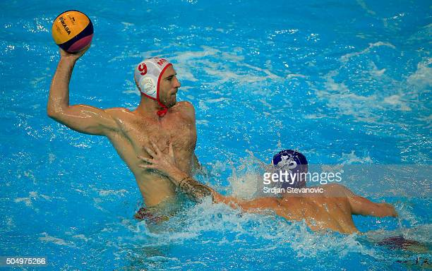 Aleksandar Ivovic of Montenegro in action against Tomas Bruder of Slovakia during the men's Preliminary Group A match between Montenegro and Slovakia...