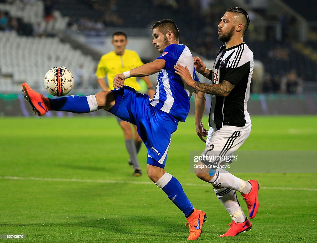 Aleksandar Jesic (L) of OFK Belgrade in action against Ivan Bandalovski (R) of FK Partizan during the Serbia Super League match between FK Partizan and OFK Belgrade at Partizan stadium August 29, 2015 in Belgrade, Serbia.