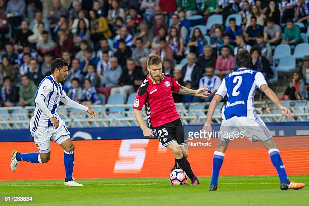 Aleksandar Katai of Alaves duels for the ball with Carlos Vela and Carlos Martinez of Real Sociedad during the Spanish league football match between...