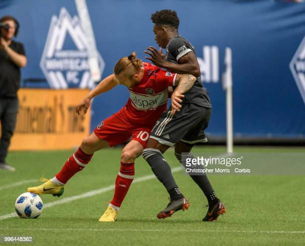 Aleksandar Katai of the Chicago Fire and Alphonso Davies of the Vancouver Whitecaps FC battle for the ball at BC Place on July 7 2018 in Vancouver...
