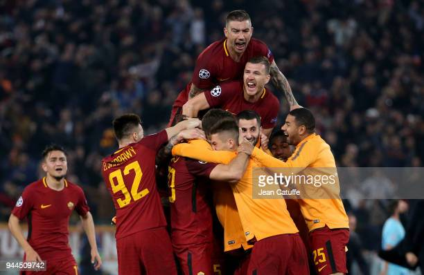 Aleksandar Kolarov Edin Dzeko of AS Roma and teammates celebrate the qualification for the semis following the UEFA Champions League Quarter Final...