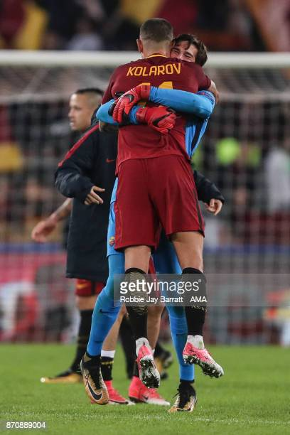 Aleksandar Kolarov of AS Roma and Alisson Becker of AS Roma celebrate at full time during the UEFA Champions League group C match between AS Roma and...