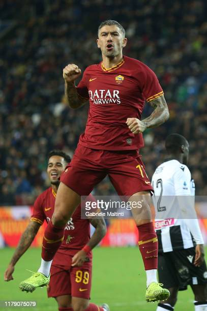 Aleksandar Kolarov of AS Roma celebrates after scoring a goal during the Serie A match between Udinese Calcio and AS Roma at Stadio Friuli on October...