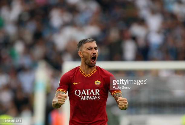 Aleksandar Kolarov of AS Roma celebrates after scoring the opening goal from penalty spot during the Serie A match between SS Lazio and AS Roma at...