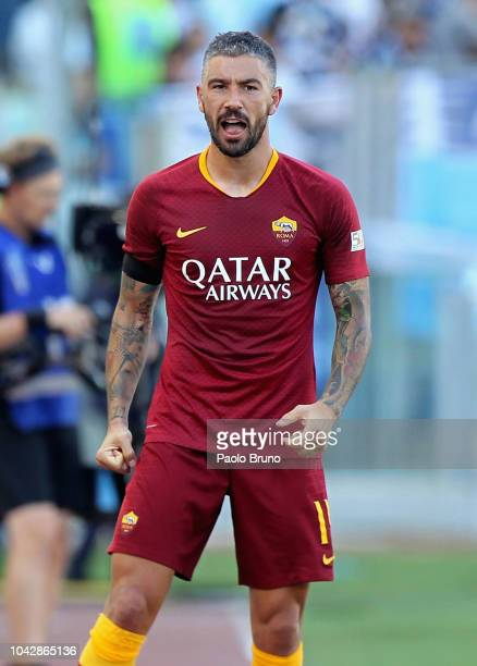 Aleksandar Kolarov of AS Roma celebrates after scoring the team's second goal during the Serie A match between AS Roma and SS Lazio at Stadio...