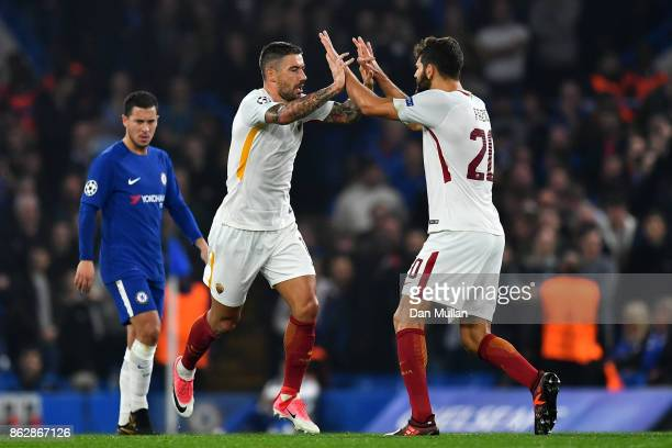 Aleksandar Kolarov of AS Roma celebrates scoring his sides first goal with Federico Fazio of AS Roma during the UEFA Champions League group C match...