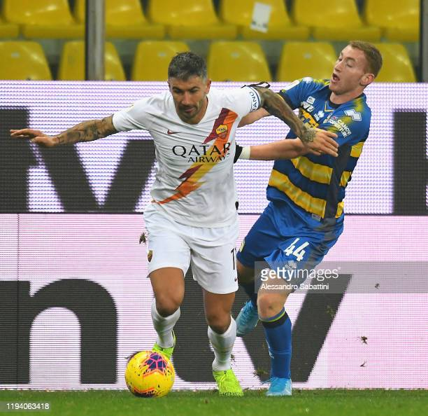 Aleksandar Kolarov of As Roma competes for the ball with Dejan Kulusevski of Parma Calcio during the Coppa Italia match between Parma Calcio and AS...