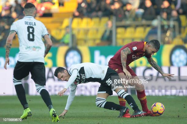 Aleksandar Kolarov of AS Roma competes for the ball with Luca Siligardi of Parma Calcio during the Serie A match between Parma Calcio and AS Roma at...