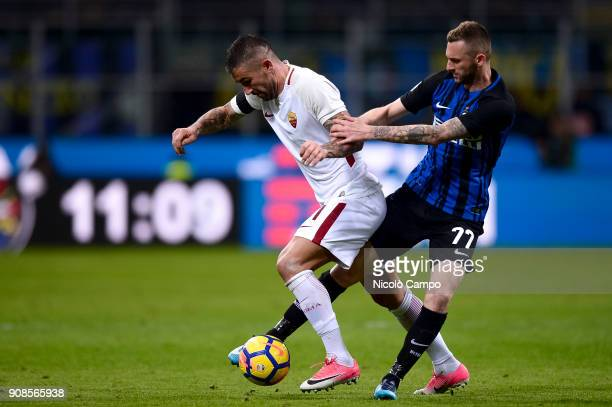 Aleksandar Kolarov of AS Roma competes for the ball with Marcelo Brozovic of FC Internazionale during the Serie A football match between FC...