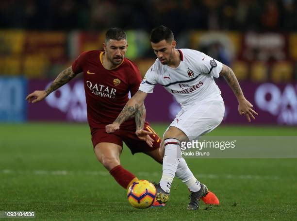 Aleksandar Kolarov of AS Roma competes for the ball with Suso of AC Milan during the Serie A match between AS Roma and AC Milan at Stadio Olimpico on...