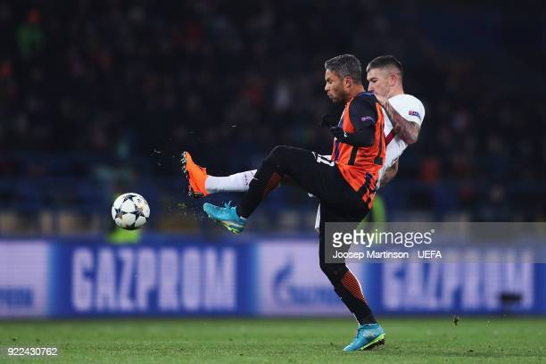 Aleksandar Kolarov of AS Roma competes with Marlos of Shakhtar Donetsk during the UEFA Champions League Round of 16 First Leg match between Shakhtar...