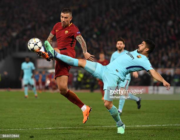 Aleksandar Kolarov of AS Roma is challenged by Luis Suarez of Barcelona UEFA Champions League Quarter Final Second Leg match between AS Roma and FC...