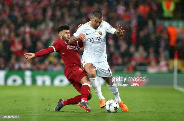 Aleksandar Kolarov of AS Roma is tackled by Alex OxladeChamberlain of Liverpool during the UEFA Champions League Semi Final First Leg match between...