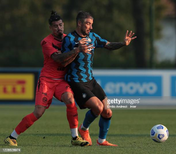 Aleksandar Kolarov of FC Internazionale competes for the ball during the PreSeason Friendly match between FC Internazionale and Lugano at the club's...