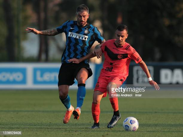 Aleksandar Kolarov of FC Internazionale is challenged during the PreSeason Friendly match between FC Internazionale and Lugano at the club's training...