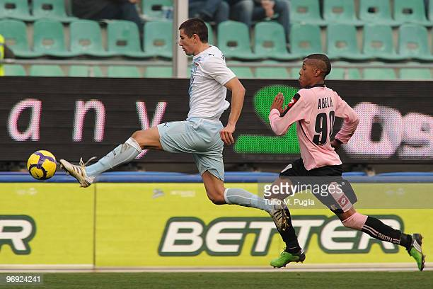 Aleksandar Kolarov of Lazio and Abel Hernandez of Palermo compete for the ball during the Serie A match between US Citta di Palermo and SS Lazio at...