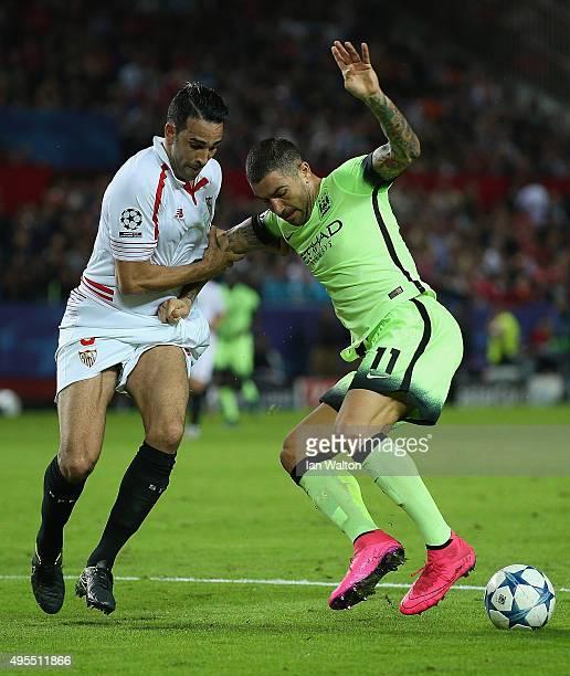 Aleksandar Kolarov of Manchester City battles with Adil Rami of Sevilla during the UEFA Champions League Group D match between Sevilla FC and...