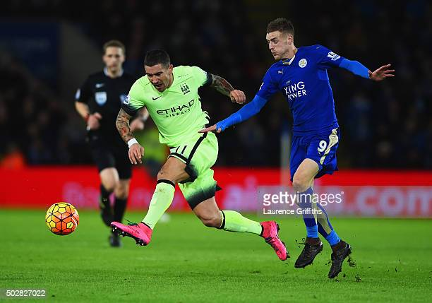 Aleksandar Kolarov of Manchester City beats Jamie Vardy of Leicester City to the ball during the Barclays Premier League match between Leicester City...