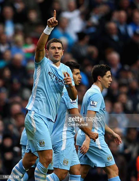 Aleksandar Kolarov of Manchester City celebrates after scoring the second goal during the Barclays Premier League match between Manchester City and...