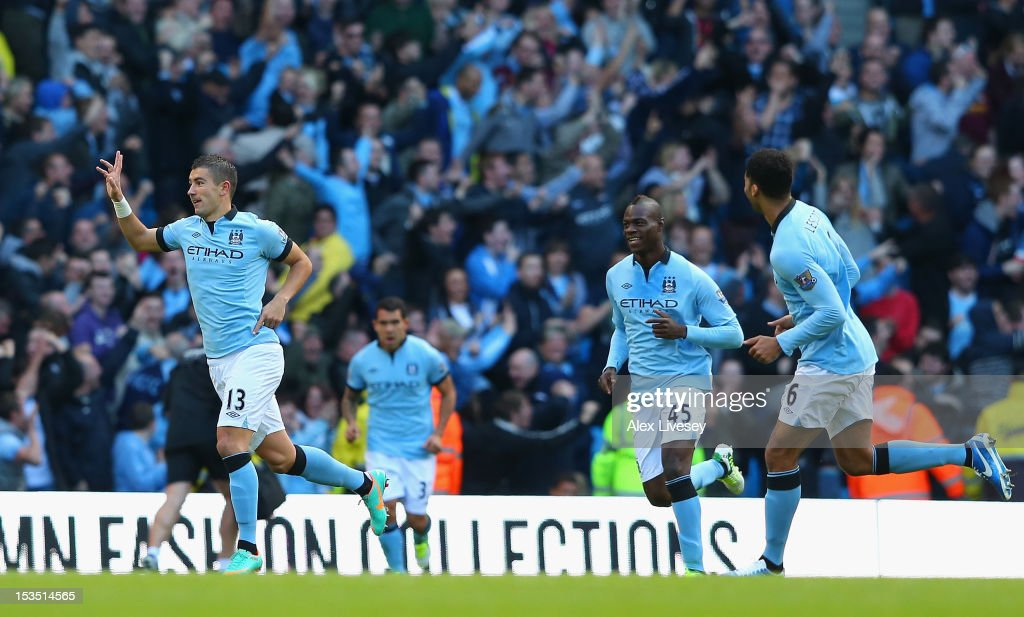 Aleksandar Kolarov of Manchester City celebrates scoring the opening goal during the Barclays Premier League match between Manchester City and Sunderland at the Etihad Stadium on October 6, 2012 in Manchester, England.